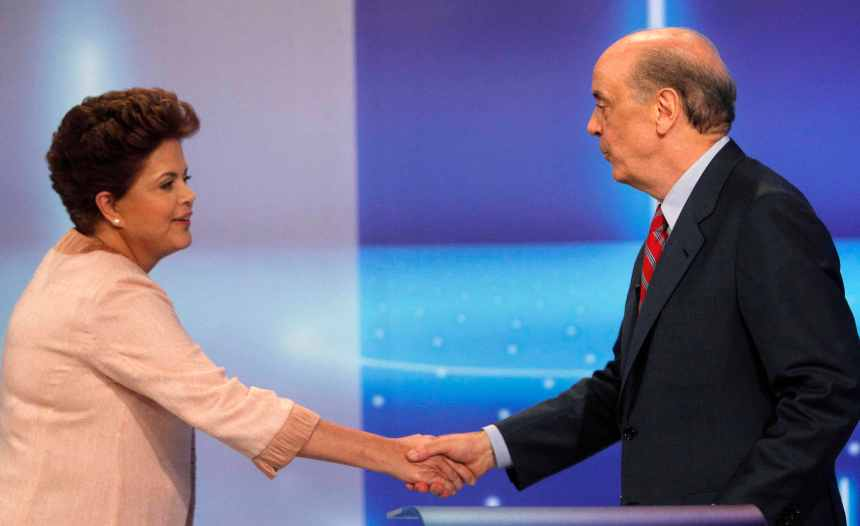 Presidential candidate Dilma Rousseff of Workers' Party shakes hands of presidential candidate Jose Serra of PSDB party in Rio de Janeiro