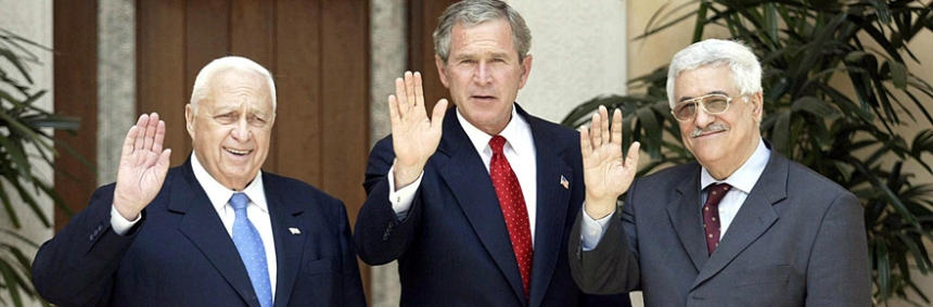 US President George W. Bush (C), Palestinian Prime Minister Mahmud Abbas (R) and his Israeli counterpart Ariel Sharon wave as they pose for a picture before their unprecedented meeting on the grounds of King Abdullah II's summer palace in Aqaba, Jordan 04 June 2003. Bush is trying to jumpstart the peace process in the Middle East.    AFP PHOTO/Luke FRAZZA